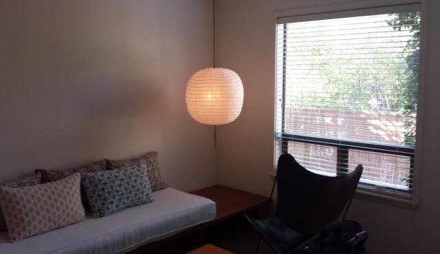 Sofa/Living area at Hotel San Jose – Room #22 The Petite Suite