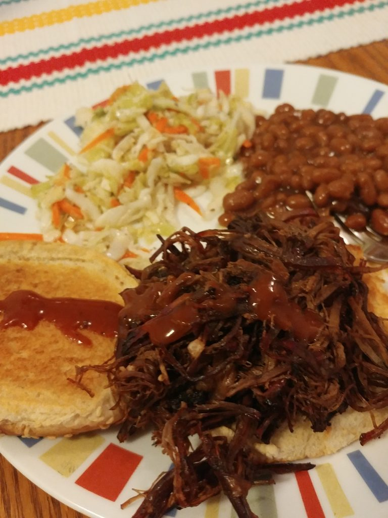 Leftover brisket slaw and beans on a toasted bun